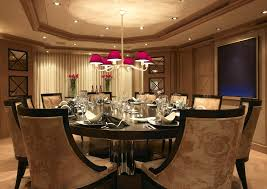 luxury dining room with patterned chair and round pedestal dining table added modern dining room table centerpieces as well as red shade chandelier decors