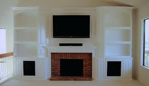 white corner entertainment center with fireplace electric custom cabinets built in