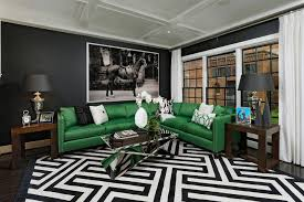 green leather l shaped sofa with striped black and white rug