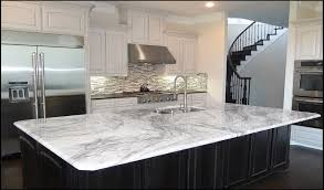 marble lookalike quartz countertop options via the sweetest digs