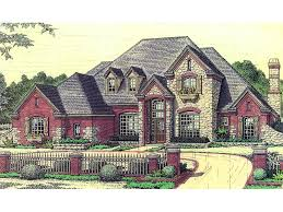 luxury european two story with stone brick and planter boxes