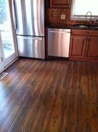 installing laminate flooring in kitchen under the cabinets