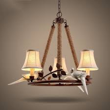 nature inspired 3 lamp rope chandelier with fabric shade in mottled rust finish for bed room