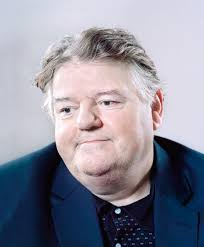 Robbie Coltrane has the most enormous feet, like two cross-Channel ferries moored at the bottom of his shins. Luckily, however, his son has excellent taste ... - Robbie-Coltrane-001