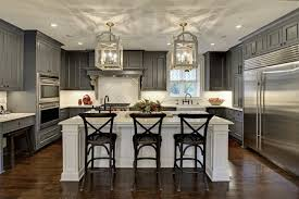 Large elegant u-shaped dark wood floor and brown floor eat-in kitchen photo