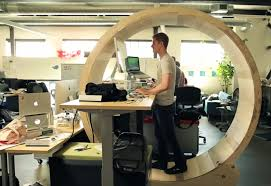 this hamster wheel treadmill desk is the ideal way to make your coworkers you
