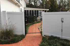 Image Steel Black Chain Link Commercial Fence With Privacy Slats Ivy Fence Company Vinyl Fence Installation And Repair