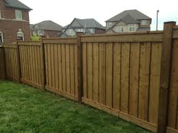 fence. Brown Pressure Treated Lumber Fence