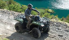 2018 honda rancher 420. contemporary rancher rider driving trx420 rancher in colour olive on rugged trail along  turquoise lake  and 2018 honda rancher 420