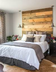wooden headboard adds warmth to the contemporary bedroom design carriage lane design build