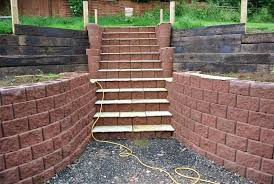 steps and retaining wall built with terraforce red garden wall interlocking plantable blocks