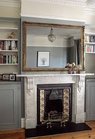 mirror above fireplace. victorian fireplace with huge mirror to fill wall space. the marble surroundings match neutral above e