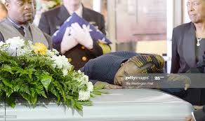Priscilla Daniels lays her head on the coffin during the funeral and...  News Photo - Getty Images