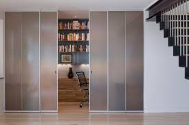 sliding office door. view in gallery small home office hidden behind wooden sliding door e