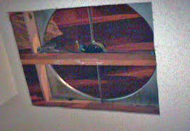 install a whole house exhaust fan yourself attic fan in position over cut in drywall ceiling