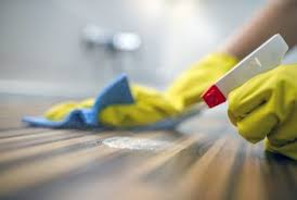 how to clean oily residue from wood furniture