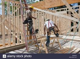 carpenters framing a house