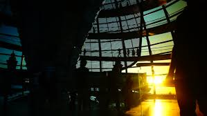 people inside elevator. berlin - august 1: people move inside the cupola of reichstag building on elevator c