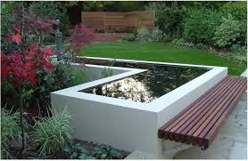 Small Picture Modern garden pond with decked bench seat cantilevered benches
