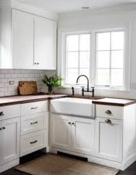 white shaker cabinets knobs white shaker kitchen cabinets dark nickel cup pulls wood counters pics