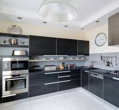 Modern Black Kitchen Designs. Dark Kitchen Cabinets With White Floor And  Walls With Stainless Steel Appliances