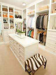 Inspiration for a timeless walk-in closet remodel in Houston with white  cabinets