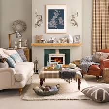 chic cozy living room furniture. ivory french country sofa with fireplace and chic rug for living room decoration ideas cozy furniture o