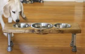 dog feeder made of wood and old metal bars