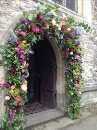 colourful fl arch for the ceremony not necessarily this large fl archsunflower fl arrangementswedding