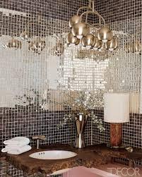 Miami powder room with mosaic mirror tiles insert - Elle Decor via Atticmag