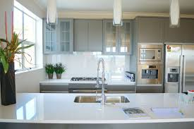 small white kitchen with marble countertop grey cabinets hanging lights steel appliances kitchens58 kitchens