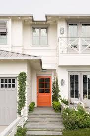Orange front door Burnt Orange White Home With Orange Front Door Decorpad White Home With Orange Front Door Transitional Home Exterior
