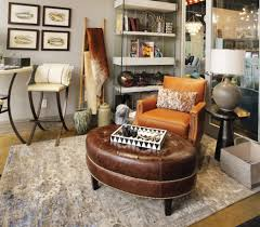 Large, padded ottomans go perfectly with sectionals as either an alternative coffee table or an extra seat. Victoria S Sneak Peek Upholstered Ottomans Design Studio Interior Solutions