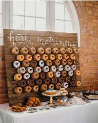 a wooden plaque donut wall is ideal for a rustic wedding and as a backdrop for