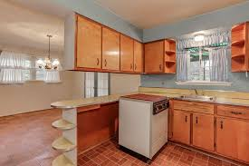 limestone tiles kitchen: transitional kitchen with limestone tile floors european cabinets drop in sink inset