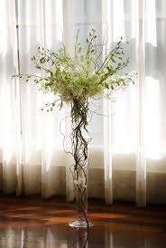 Some of the tables will have tall centerpieces of overflowing lemon lime  hydrangeas,