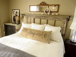 bedrooms ideas fireplace mantel firewood storage floor lamp foot of the bed grey monochromatic neutral colors roman shades side table upholstered headboard