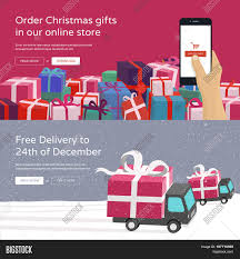 Hand holding mobile phone and ordering Christmas gifts & Free Delivery  service for online store.
