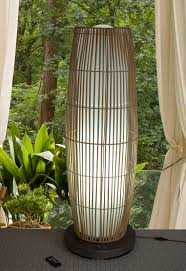 floor lamps for patio with bamboo lamps material and green foliages around