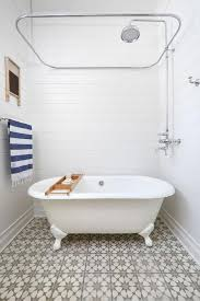 small clawfoot tub. Victorian Printed Floor Tiles With Small Clawfoot Tub Using Chrome Finished Shower Ring U