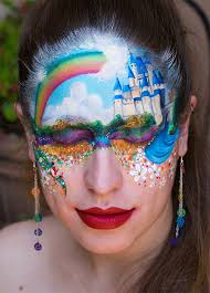 down the face a rainbow of flowers framing the face with the centrepiece a stunning rainbow that is met with fluffy clouds a gorgeous design marta
