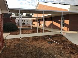 quality aluminum home improvement offers a wide range of durable canvas awnings flat aluminum and metal awnings custom built awnings covered walkways