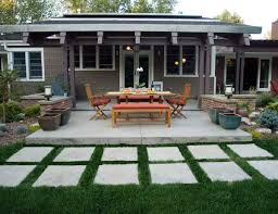 modern concrete patio. Modern Style Patio With Hand Troweled Concrete And Matching Brick Seat Walls By Mile High Landscaping, Denver, CO