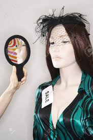 Woman Holding Mirror By Mannequin Stock Photo Picture And Royalty