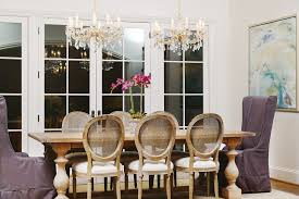 farm house table dining room traditional with 2 crystal chandeliers abstract image by allure homes llc