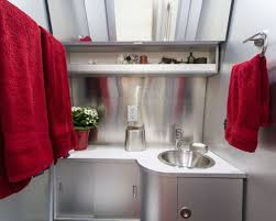 airplane bathroom. inspiration for a small industrial bathroom remodel in los angeles with laminate countertops airplane