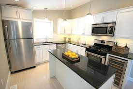 shaker kitchen cabinets white white shaker flipping show a farmhouse style kitchen with white shaker cabinets