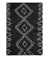 love this black ivory geometric maya rug