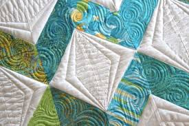 Connect the Dots With Free-Motion Quilting: Inspiration & Tips & White Quilt with Teal Zigzag Design Adamdwight.com