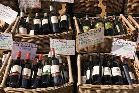 wine in rue mouffetard displaying baskets of bottles